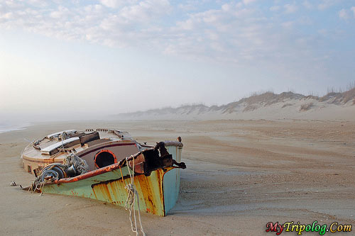 a lonely boat wreckage on the beach,lonely,beach,boat,wreckage,hatteras,island,N.C