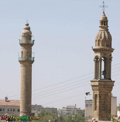 A Mosque minaret and a Bell Tower in the same square,midyat,mardin,bell,tower,minaret,turkey