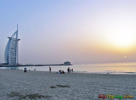 jumeirah beach,dubai,burj al arab view,uae,people on the beach,sunset